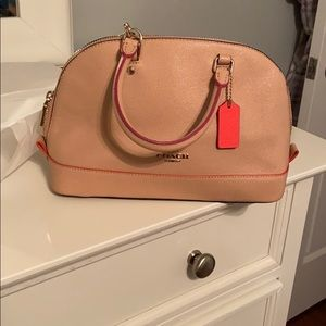 Light beige, pink and orange Coach purse